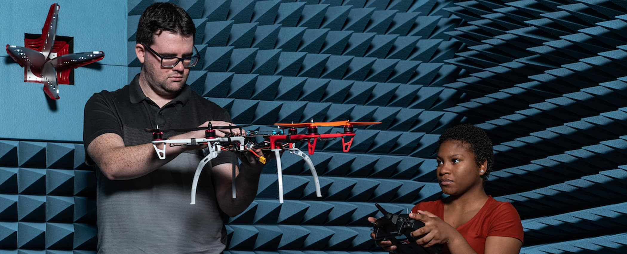 Students work with a drone in the MicaPlex.